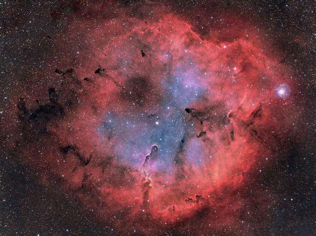 Sharpless 119 is a largish emission nebula in constellation Cygnus. There are not too many images of it around due the close proximity of eye catchers, North America and Pelican Nebulae. Sh2-199 locates just three degrees East from the NGC 7000, North America Nebula. A bright magnitude 5 star 68 Cygni, can be seen at very center of the image above. There are several dark globules at the Southern part of the nebula.  This image covers about three degrees of sky, that's six full Moons side by side.  Technical details:  Processing work flow: Image acquisition, MaxiDL v5.07. Stacked and calibrated in CCDStack2. Deconvolution with a CCDStack2 Positive Constraint, 33 iterations. Levels, curves and color combine in PS CS3.  Optics, Tokina AT-X 300mm camera lens at f2.8 Camera, QHY9 Guiding, SXV-AO @ 6,5Hz Image Scale, 3,5 arcseconds/pixel Exposures H-alpha 10x1200s, binned 1x1O-III 3x1200s, binned 3x3 S-II 3x1200s, binned 2x2 Total exposure time ~5h